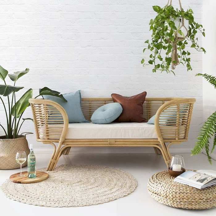 Rattan furniture with brown and blue pillows