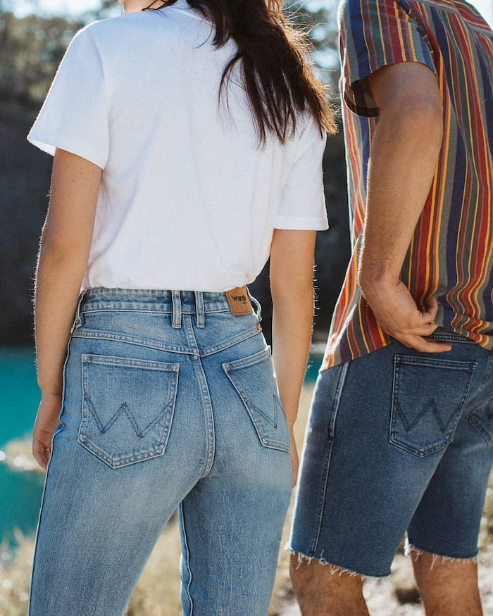 man and woman wearing denim jeans and shorts