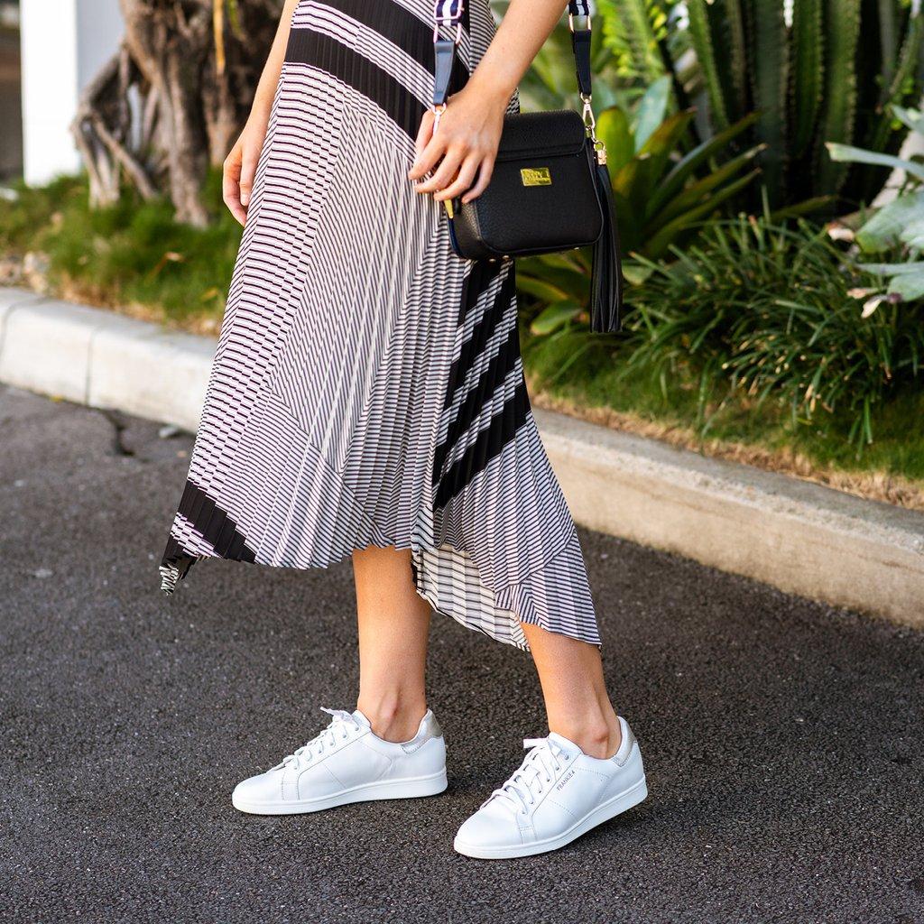 Women wearing white Walking Shoes
