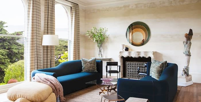 home decor for living room, blue sofas, coffee table and mirror