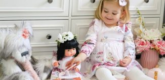little-girl-with-miniland-doll