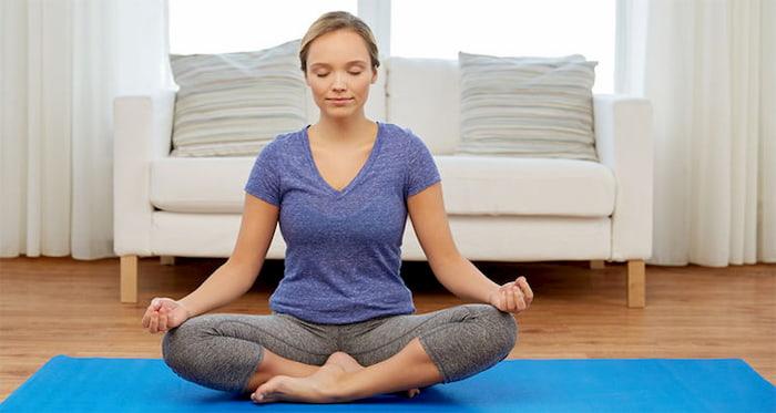 meditating-on-yoga-mat