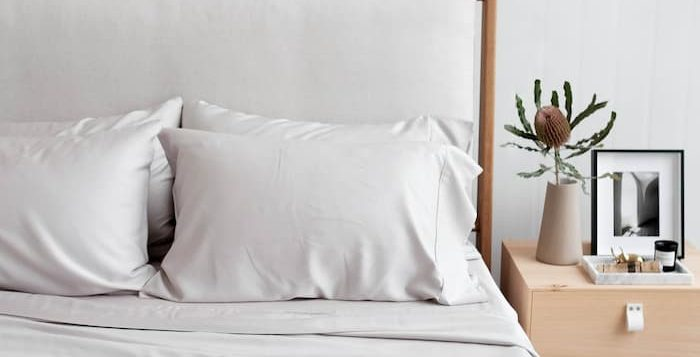 organic bamboo sheets for bedroom with bedside table