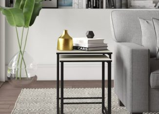 stacking side tables for living room near sofa bed with book on it
