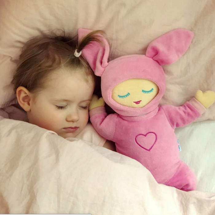 picture of a baby sleeping beside a Lulla doll