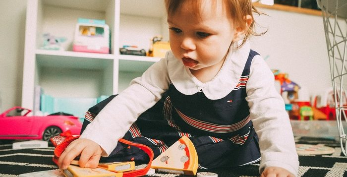 picture of baby playing with toys