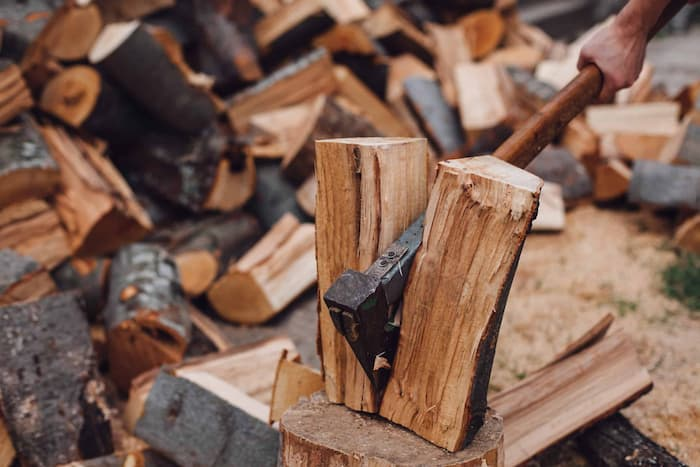 axe splitting wood scaled