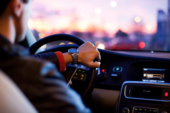 203767-close-up-of-a-man-with-watch-driving-a-car-hand-on