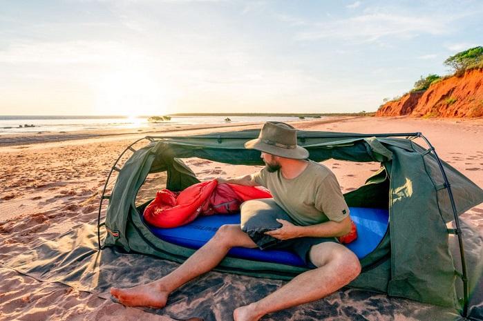 man camping on the beach