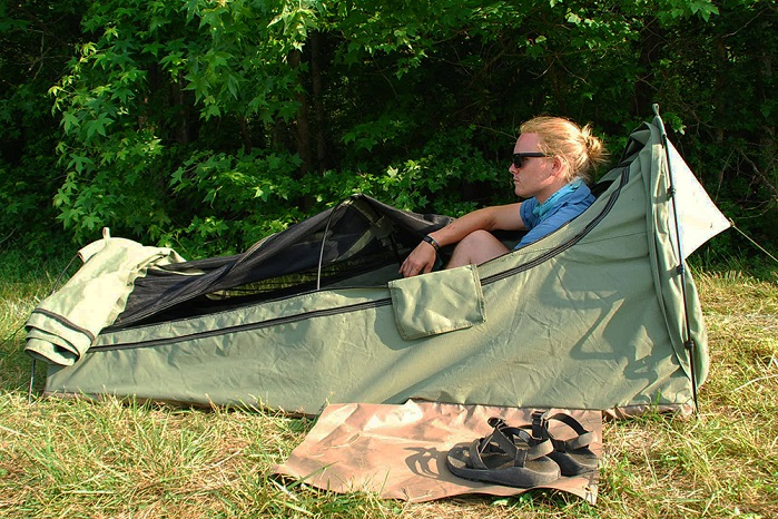 boy camping in swag