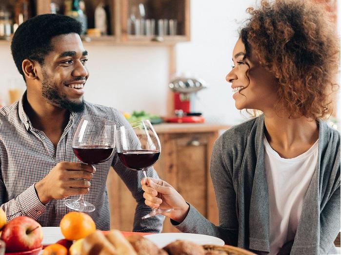 couple celebrating anniversary with wine