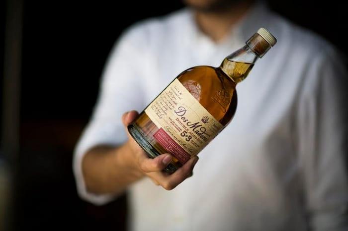 man showing a rum essences