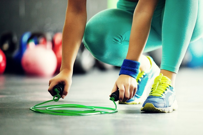 close-up of woman holding the jumping rope